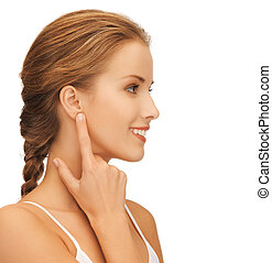 woman pointing to ear - picture of beautiful woman pointing...