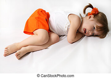 Small girl is tired against the white background