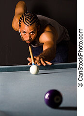 Lining up Pool Shot - African American male lining up a...