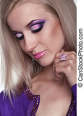 Glamour portrait of beautiful woman model with eye shadows makeup.