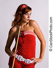 Redhead girl holding a pool cue - Redhead holding a pool cue...