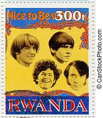 RWANDA - CIRCA 2003 : stamp printed in Rwanda shows the Monkees american pop rock group popular in 1960th, circa 2003