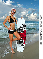 Girl with Wakeboard - Beautiful girl with wakeboard on the...