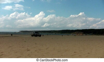 SUV car crosses the beach