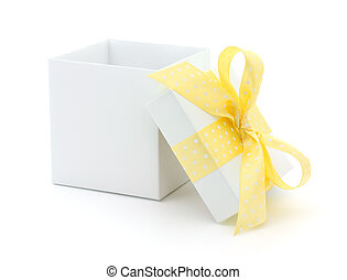 open gift box - Open empty gift box and yellow bow....