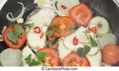 cooking fish fillet - fish fillet fried with fresh herbs in...