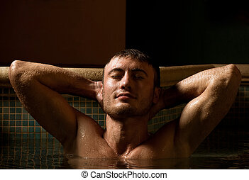 Young wet sexy muscular man