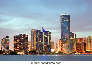 Miami Florida sunset over downtown illuminated business and...