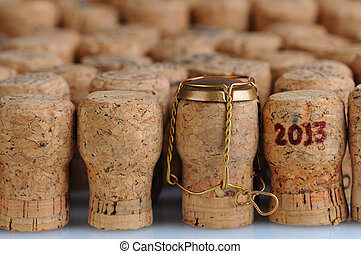 Champagne Corks With 2013 Date - Closeup of a large group of...