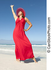 Confident happy lady in red at beach - Beautiful elegant...