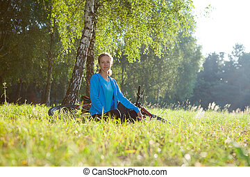 Woman cyclist relaxing in spring park