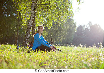 Woman cyclist enjoying relaxation in spring sunny park