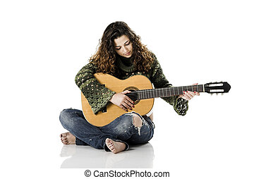 Playing guitar - Beautiful woman isolated on white playing...