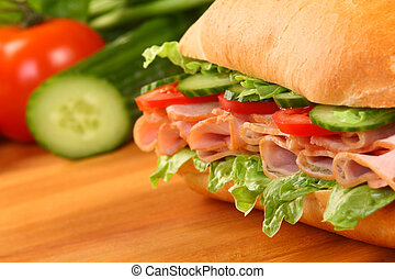 Fresh ham sandwich on wooden board