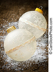 Christmas baubles on old wooden background