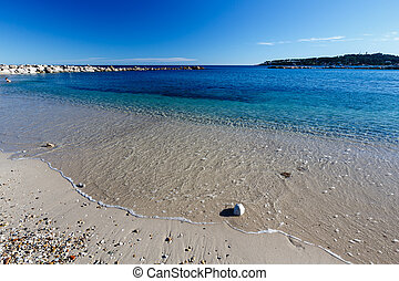 Sunny Beach and Breakwater in Antibes on French Riviera,...