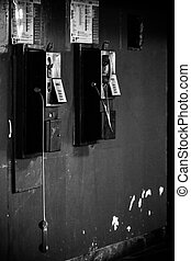 Public phones - Black public phone hang on the wall
