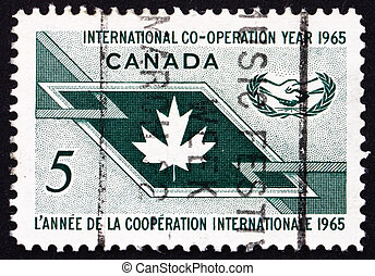 CANADA - CIRCA 1965: a stamp printed in the Canada shows Maple Leaf and ICY Emblem, International Cooperation Year, circa 1965