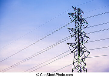 Tree line. - High voltage towers. A high voltage power...