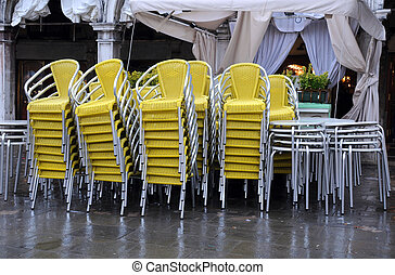 Stack of Chairs and Tables in the Fall - Stack of chairs and...