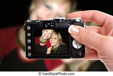 best friends - woman takes snapshop of best friends smiling