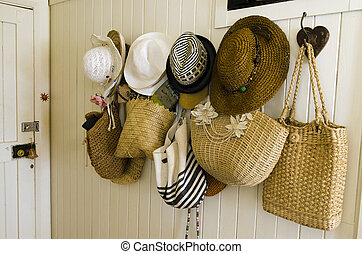 Woman straw hats and shoulder bags collection - A collection...
