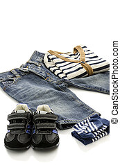 Baby clothes - Prepared clothes for a baby boy isolated on a...