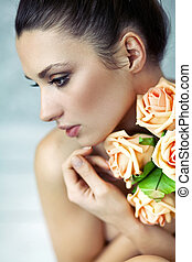 Young lady keeping roses - Young lady keeping bouquet of...