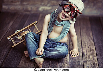 Small boy playing - Picture of small boy playing wooden...