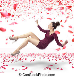 Attractive lady falling down over rose petals background