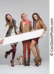 Teenage girls having fun with empty board