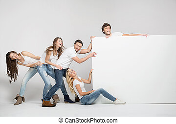 Business people pulling an empty white board