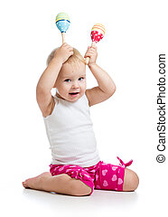 funny baby girl playing with musical toy