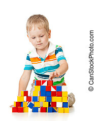Child boy playing toy blocks