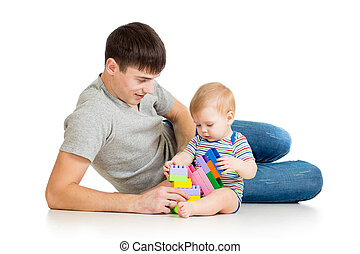 baby boy and father play together - happy father playing...