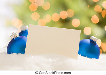 Blue Christmas Ornaments Behind Blank Off-white Card Ready...
