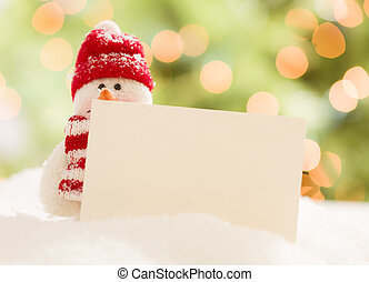 Cute Snowman with Blank White Card Over Abstract Background...