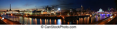 Moscow, Russia. Night. Panoramic view from the embankment of the Moskva River in the Kievsky train station, international business centre and bridges