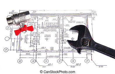 Plumbing parts and tools on the drawing, closeup