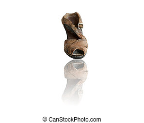 Old ceramic shoe with reflection, isolated on a white background