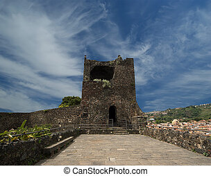 A medieval castle built on a steep rock formation overhanging on the Ionian sea. Acicastello, close to Catania; Sicily. Italy.