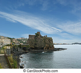 A medieval castle built on a steep rock formation...