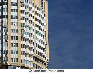 Wall of a residential high-rise building with windows and balconies, Moscow, Russia