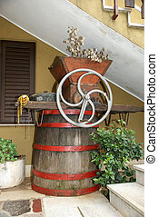 historic wine press for extraction juice from grapes