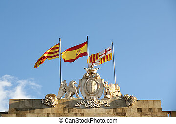 Flags of Barcelona, Catalonia and Spain on the roof of...