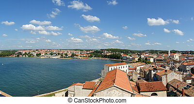 Panoramic landscape with the sky, the sea and rooftops,...