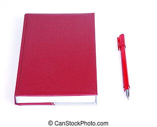 red notebook for reference daily notes with a pen on a white background