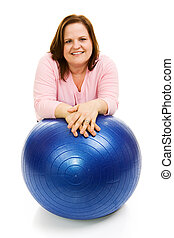 Woman With Pilates Ball - Beautiful plus sized model in...
