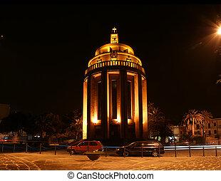 The modern Catholic Church at night. Syracuse (Siracusa, Sarausa)-- historic city in Sicily, Italy