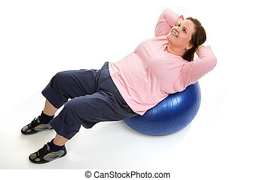 Crunches on Pilates Ball - Beautiful plus sized model doing...